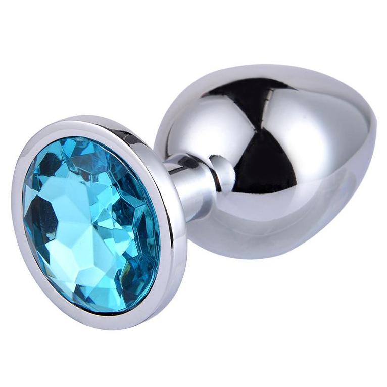 Большая серебристая анальная пробка с голубым кристаллом. Вид 1.