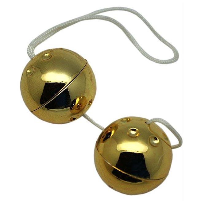 Золотистые шарики со смещённым центром тяжести. Вид 1.