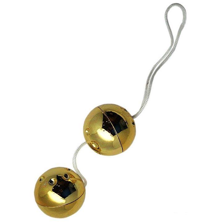 Золотистые шарики со смещённым центром тяжести. Вид 2.