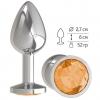Серебристая анальная втулка с оранжевым кристаллом. Вид 1.